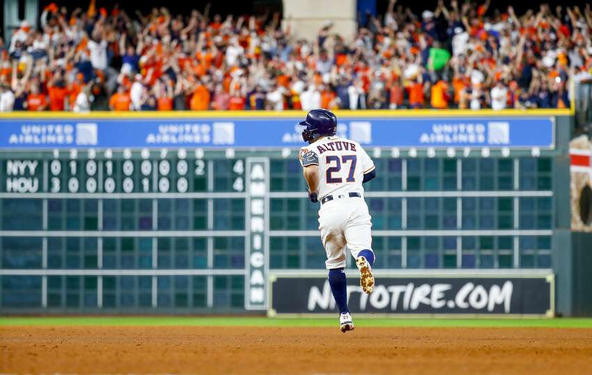 Houston Astros second baseman Jose Altuve (27) hits a two-run, walk-off, series-winning run in the bottom of the ninth inning of Game 6 of the American League Championship Series at Minute Maid Park in Houston on Saturday, Oct. 19, 2019.