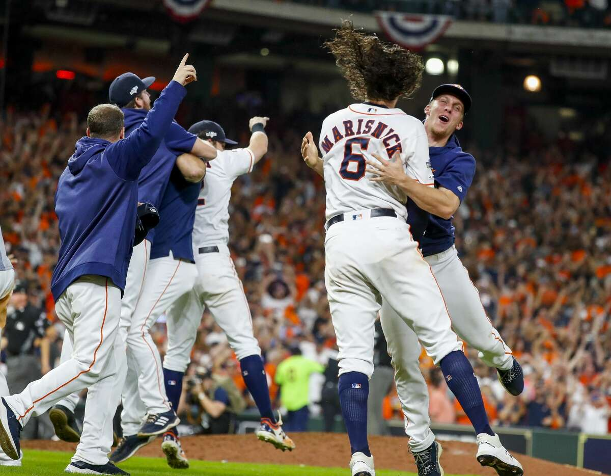 Houston Astros center fielder Jake Marisnick (6) celebrates after the Astros win the American League Championship Series at Minute Maid Park in Houston on Saturday, Oct. 19, 2019.