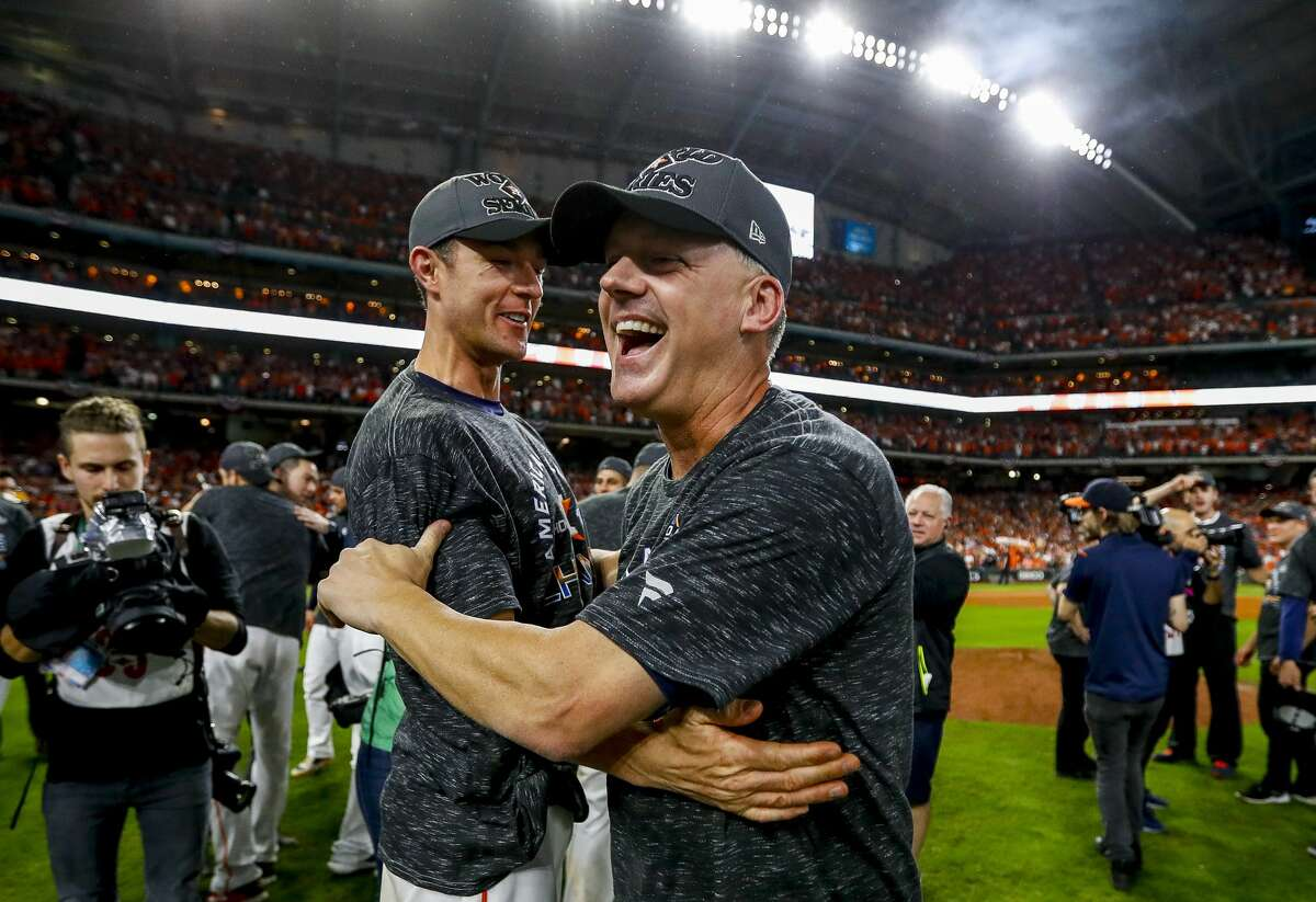 Houston Astros manager AJ Hinch (14) celebrates after the Astros win the American League Championship Series at Minute Maid Park in Houston on Saturday, Oct. 19, 2019.
