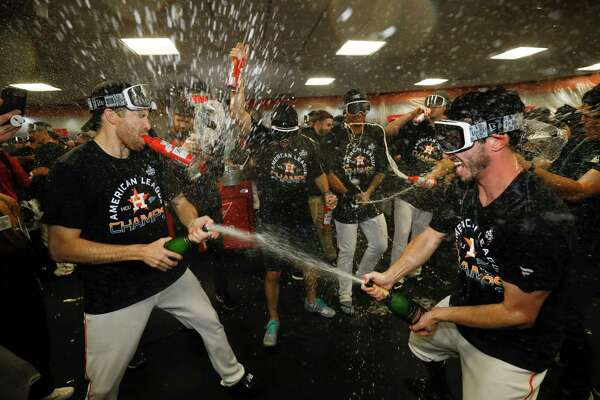 Houston Astros in the locker room after winning Game 6 of baseball's American League Championship Series against the New York Yankees Sunday, Oct. 20, 2019, in Houston. The Astros won 6-4 to win the series 4-2. (AP Photo/Matt Slocum)