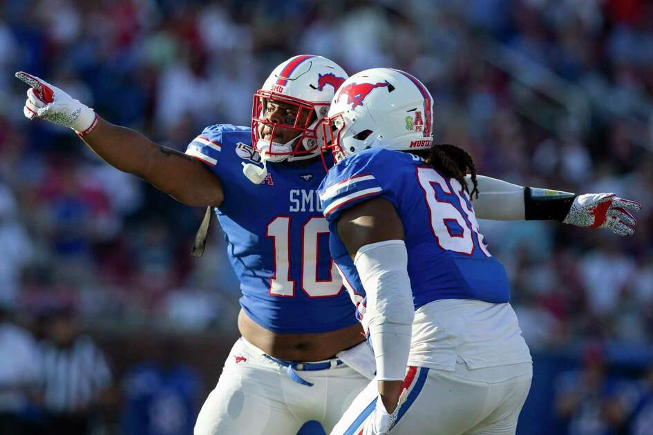 SMU defensive tackles Terrance Gipson (10) and Chris Biggurs (68) celebrate a defensive stop during the third quarter of an NCAA college football game against Temple in Dallas, Saturday, Oct. 19, 2019. (AP Photo/Sam Hodde)
