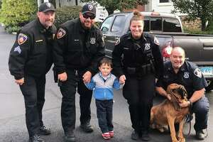 Sgt. McAllister, Officer Vitti and K9 Badge, Officer Miller and Officer Yanicky all escorted Luke to school on Oct. 18.