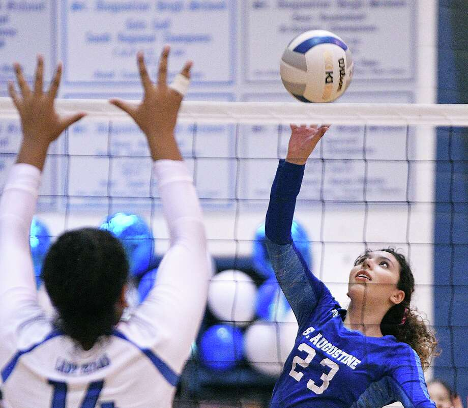Kelly Samano and the Lady Knights were swept by Victoria St. Joseph (25-15, 25-20, 25-20) in the season finale on Saturday. Photo: Cuate Santos /Laredo Morning Times / Laredo Morning Times
