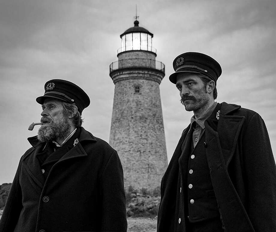 "Robert Pattinson and Willem Dafoe in ""The Lighthouse."" (Eric Chakeen/A24/IMDb/TNS) Photo: Eric Chakeen/A24, HO / TNS / IMDb"