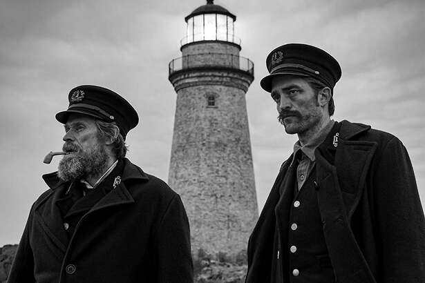 "Robert Pattinson and Willem Dafoe in ""The Lighthouse."" (Eric Chakeen/A24/IMDb/TNS)"