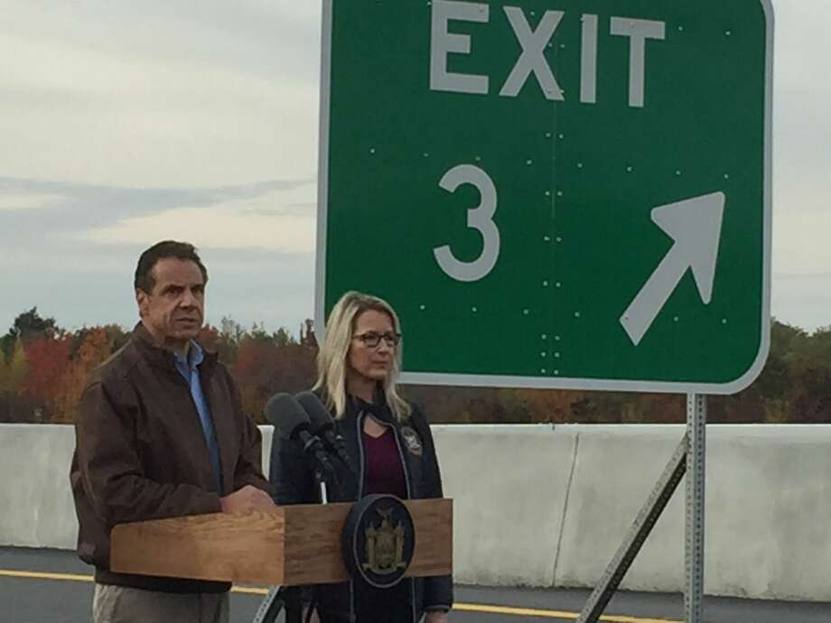 Gov. Andrew Cuomo and Kelly Cummings, director of state operations, stand on the ramp for Exit 3 few hours before another part of the exit was expected to open for travel. Photo: Mike Goodwin / Times Union