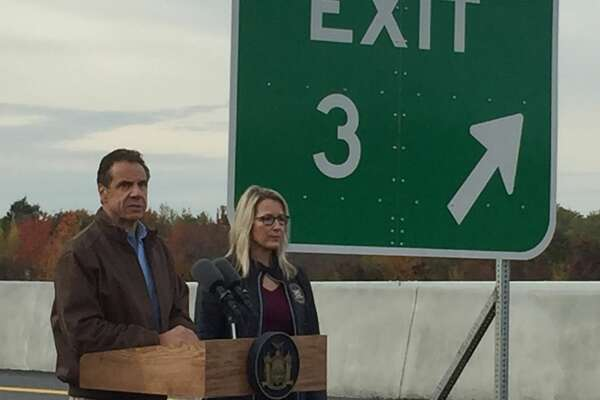 Gov. Andrew Cuomo and Kelly Cummings, director of state operations, stand on the ramp for Exit 3 few hours before another part of the exit was expected to open for travel.