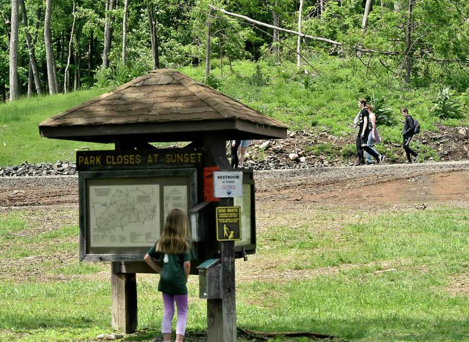 """Hamden, Connecticut - Friday, June 14, 2019: Sleeping Giant State Park reopened to the public on Friday. The park has been closed since May 2018 as the result of damage caused by a tornado and severe storms, according to CT.Gov. Work has been completed making the park and the trails safe for hikers and picnicking visitors. The cost of the restoration totaled $735,000 and approximately 75% will be reimbursed by the Federal Emergency Management Agency. Sleeping Giant Park is over 1,400 acres of land, """"including almost 2-miles of mountaintop resembling a large human figure lying in repose, the 'sleeping giant'"""". Photo: Peter Hvizdak / Hearst Connecticut Media / New Haven Register"""