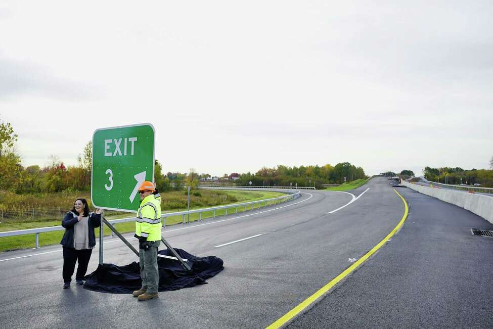 Marie Therese Dominguez, left, New York State commissioner of transportation, and Wahid Albert, a chief engineer for DOT, pose for a photo on a portion of the new exit 3 off of Interstate 87 on Sunday, Oct. 20, 2019, in Colonie, N.Y. (Paul Buckowski/Times Union)