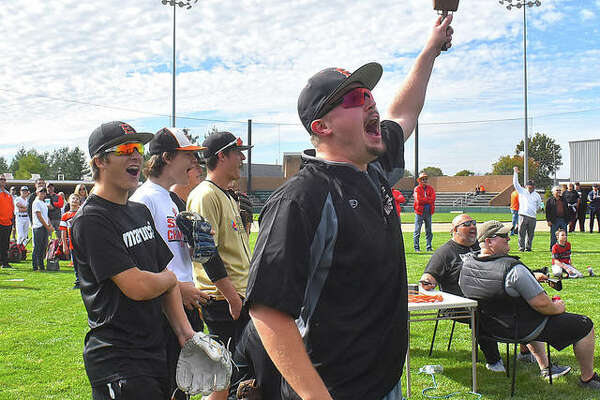 EHS senior Jacob Kitchen rings the cowbell to signal a home run during Saturday's derby at Tom Pile Field.