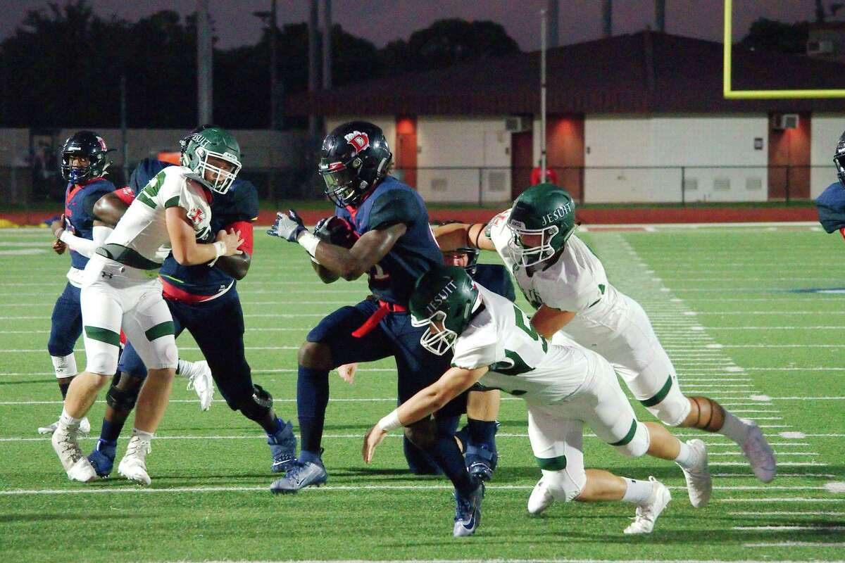 Dawson's Ja'Den Stewart (21), shown here against Strake Jesuit, powered the Eagle running game against George Ranch Friday night.