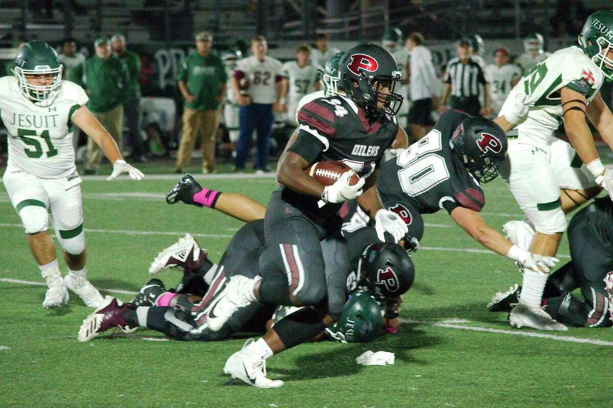 Pearland's Josef Nelson (34) finds running room in the Strake Jesuit defense Friday at The Rig.