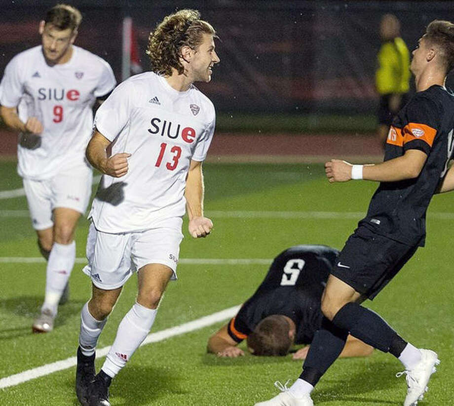 SIUE's Kelby Phillips (13) celebrates after his first-half goal in front of Bowling Green's Tom Wrobel (5) in Saturday night's 2-0 win over the falcons at Korte Stadium. Photo: Scott Kane, SIUE Athletics | For The Telegraph