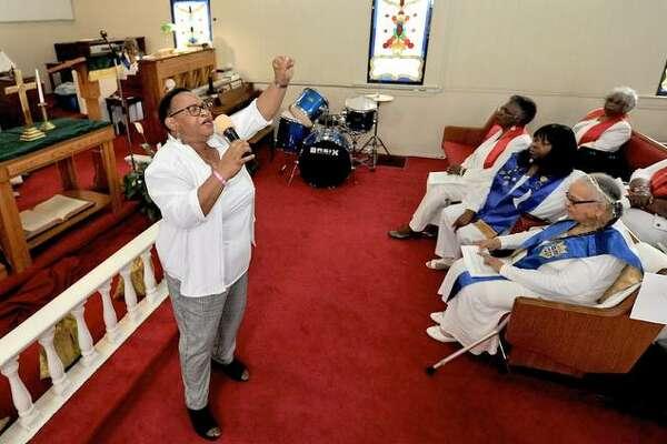 Wesley Chapel African Methodist Episcopal (A.M.E.) Minister of Music Aretha Clemons sings during the Maggie Jones Women's Missionary Society Annual Day at the Wesley Chapel A.M.E. Saturday in Edwardsville. Church members from across the region attended this year's conference.