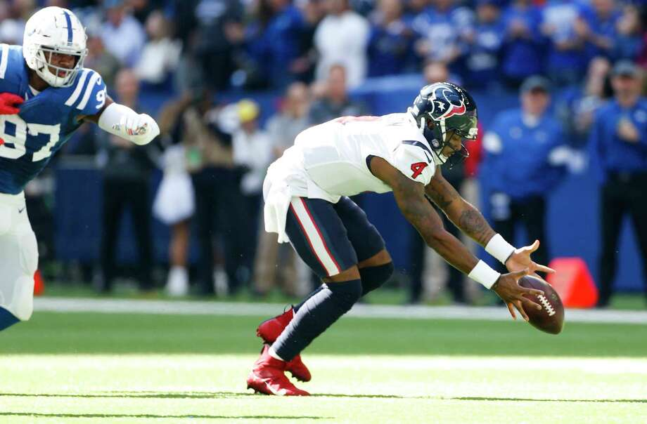 Texans quarterback Deshaun Watson (4) loses the ball as Colts defensive tackle Al-Quadin Muhammad (97) adds pressure in the first half Sunday at Lucas Oil Stadium. Photo: Elizabeth Conley, Staff Photographer / © 2018 Houston Chronicle