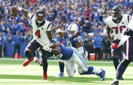 Houston Texans quarterback Deshaun Watson (4) avoids a sack by Indianapolis Colts defensive end Justin Houston (99) in the first half at Lucas Oil Stadium on Sunday, Oct. 20, 2019 inIndianapolis.