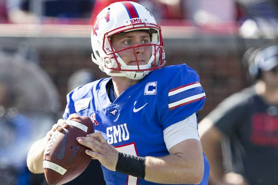 SMU quarterback Shane Buechele (7) prepares to throw the ball during the second quarter of an NCAA college football game against Temple in Dallas, Saturday, Oct. 19, 2019. (AP Photo/Sam Hodde)