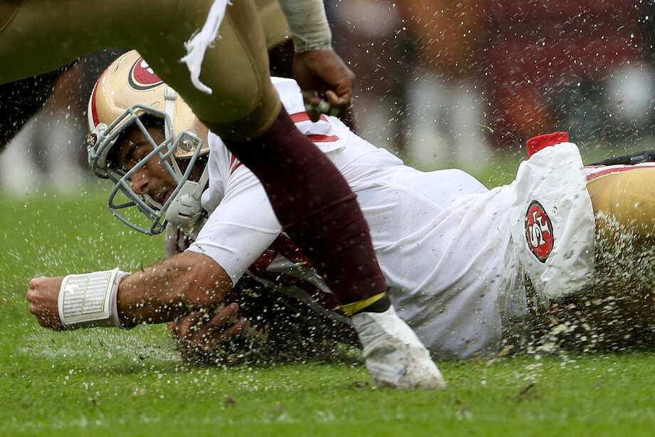Jimmy Garoppolo #10 of the San Francisco 49ers dives with the ball against Montez Sweat of Washington during the first half in the game at FedExField on October 20, 2019 in Landover, Maryland. (Photo by Rob Carr/Getty Images) Photo: Patrick Smith/Getty Images