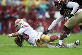 Jimmy Garoppolo #10 of the San Francisco 49ers dives with the ball against Montez Sweat of Washington during the first half in the game at FedExField on October 20, 2019 in Landover, Maryland. (Photo by Rob Carr/Getty Images)