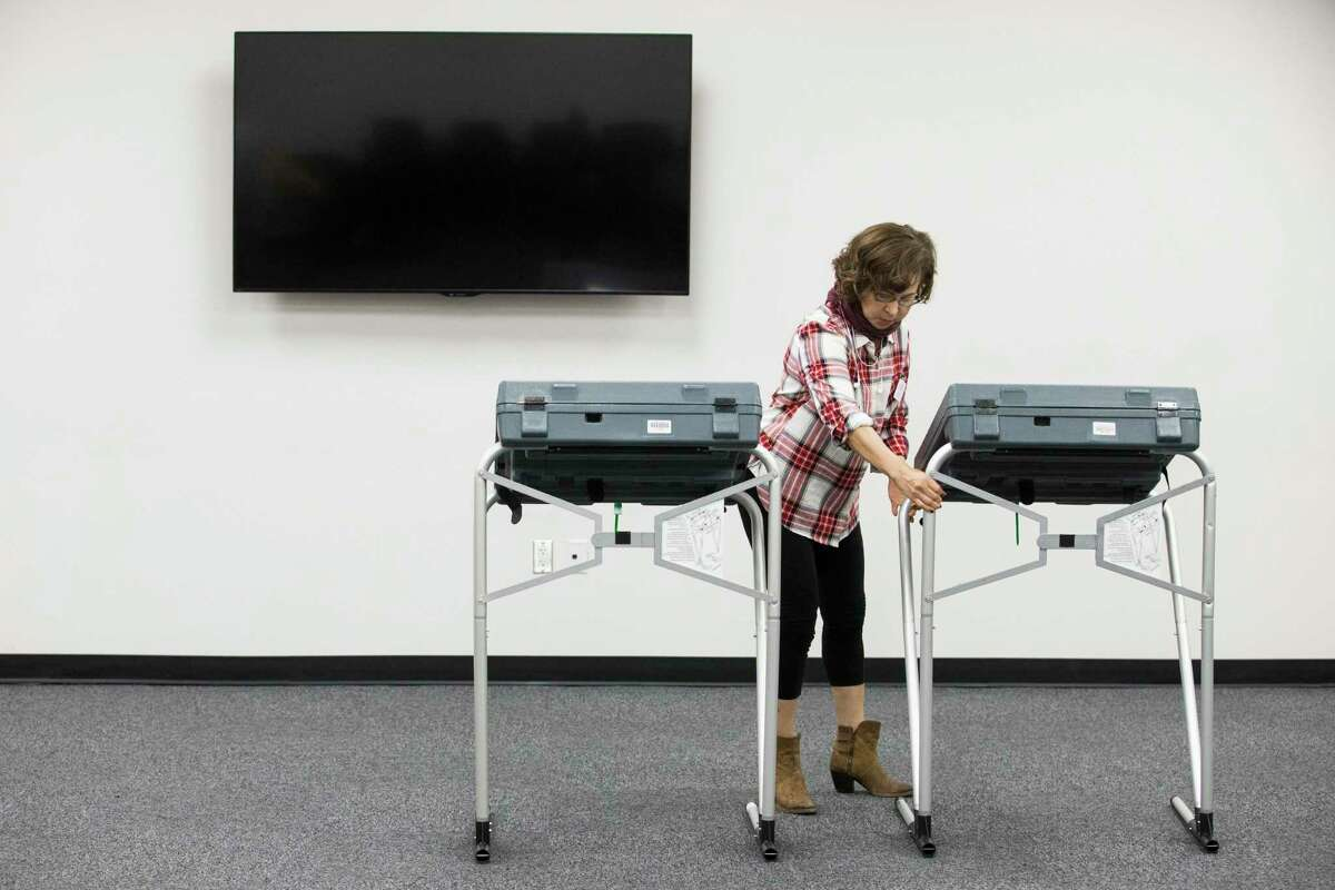 Harris County County Attorney Conference Center early voting election clerk Ana Coello setting up the voting machines on Friday, Oct. 18, 2019, in Houston. Early voting begins Monday ahead of the Nov. 5 election, when Houston and Harris County voters will cast ballots for mayor, city council, controller and a host of referendums and other offices.