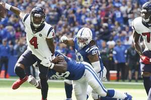 Houston Texans quarterback Deshaun Watson (4) avoids a sack by Indianapolis Colts defensive end Justin Houston (99) in the first half at Lucas Oil Stadium on Sunday, Oct. 20, 2019 in Indianapolis.
