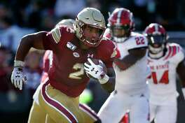 New London's AJ Dillon, who ran for 223 yards in Boston College's win over North Carolina State, is closing in on the Eagles' career rushing record.