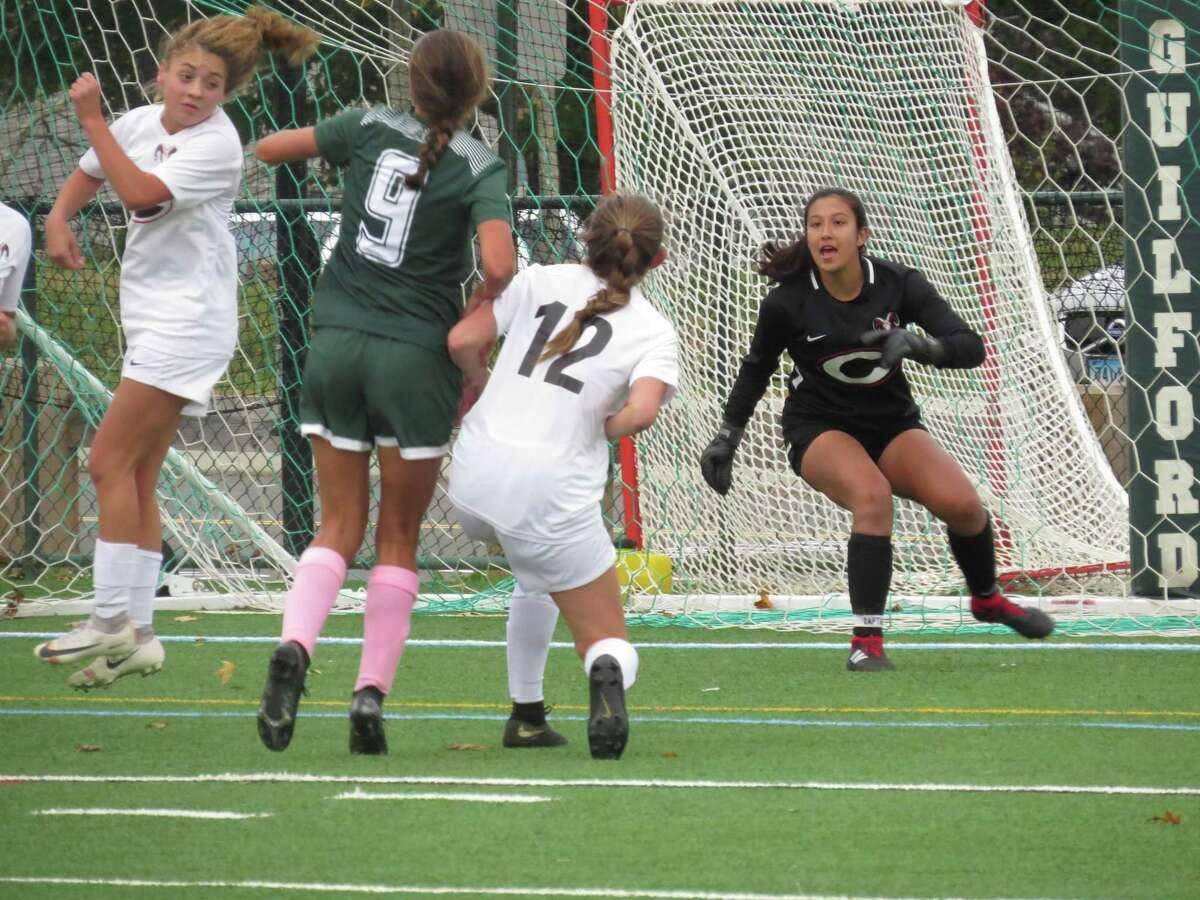 Simone Rosenberg, right, has had a strong season in goal for the Cheshire girls soccer team, helping the Rams post seven shutouts.