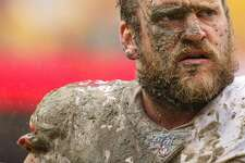 LANDOVER, MARYLAND - OCTOBER 20: Covered in mud, offensive guard Mike Person #68 of the San Francisco 49ers looks on after making a tackle on defensive back Troy Apke #30 of the Washington Redskins (not pictured) during the third quarter at FedExField on October 20, 2019 in Landover, Maryland. (Photo by Patrick Smith/Getty Images)