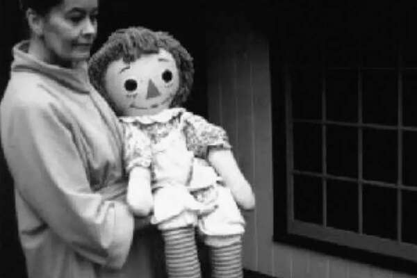 Lorraine Warren holds Annabelle, the Raggedy Ann doll displayed at the Warren's Occult Museum, in Monroe, Conn.