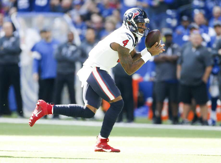 Houston Texans quarterback Deshaun Watson (4) holds onto after losing control against Indianapolis Colts in the first half at Lucas Oil Stadium on Sunday, Oct. 20, 2019. Photo: Elizabeth Conley/Staff Photographer