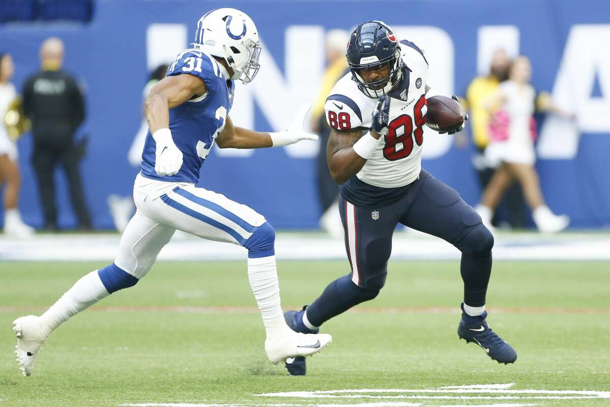 Houston Texans tight end Jordan Akins (88) runs the ball against Indianapolis Colts cornerback Quincy Wilson (31) in the second half at Lucas Oil Stadium on Sunday, Oct. 20, 2019. Indianapolis Colts won the game 30-23.