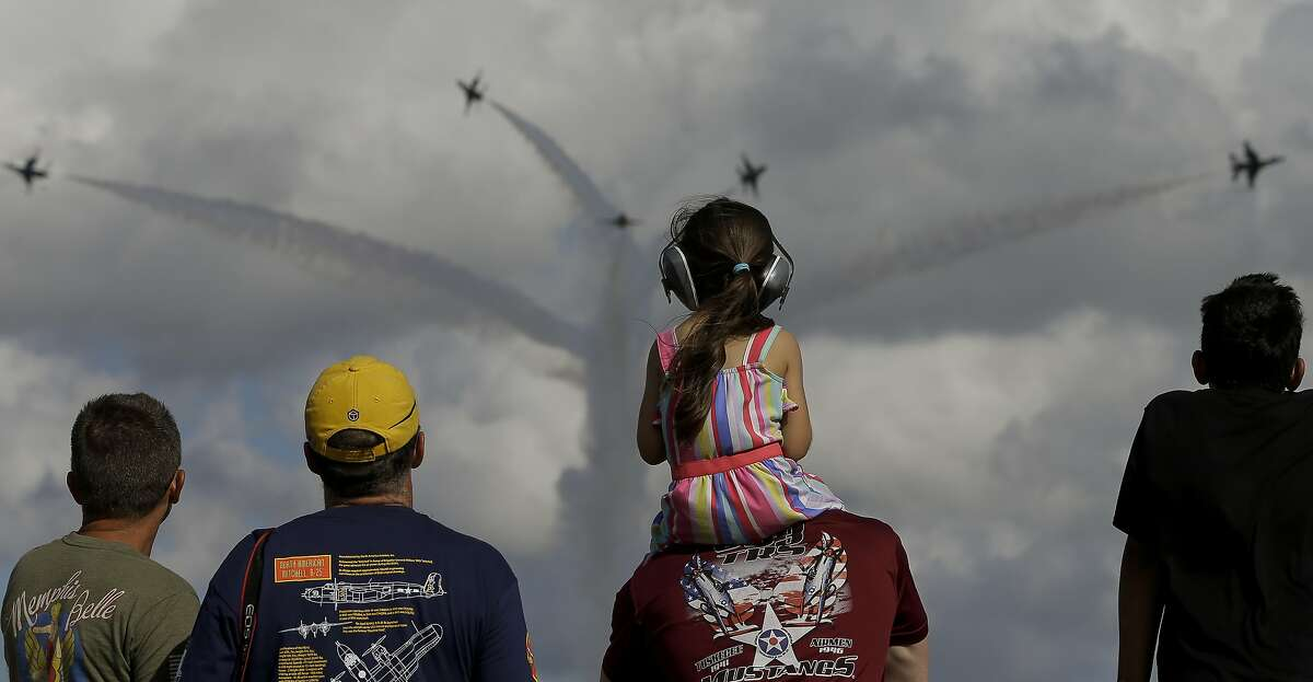 People watch as the United States Air Force Thunderbirds perform at the 35th Annual Commemorative Air Force Wings Over Houston Airshow at Ellington Field on Sunday, Oct. 20, 2019, in Houston.