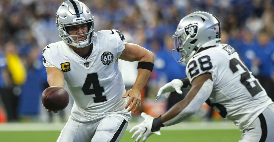 Oakland Raiders quarterback Derek Carr (4) hands off to running back Josh Jacobs (28) during the first half of an NFL football game against the Indianapolis Colts in Indianapolis, Sunday, Sept. 29, 2019. (AP Photo/AJ Mast) Photo: AJ Mast/Associated Press