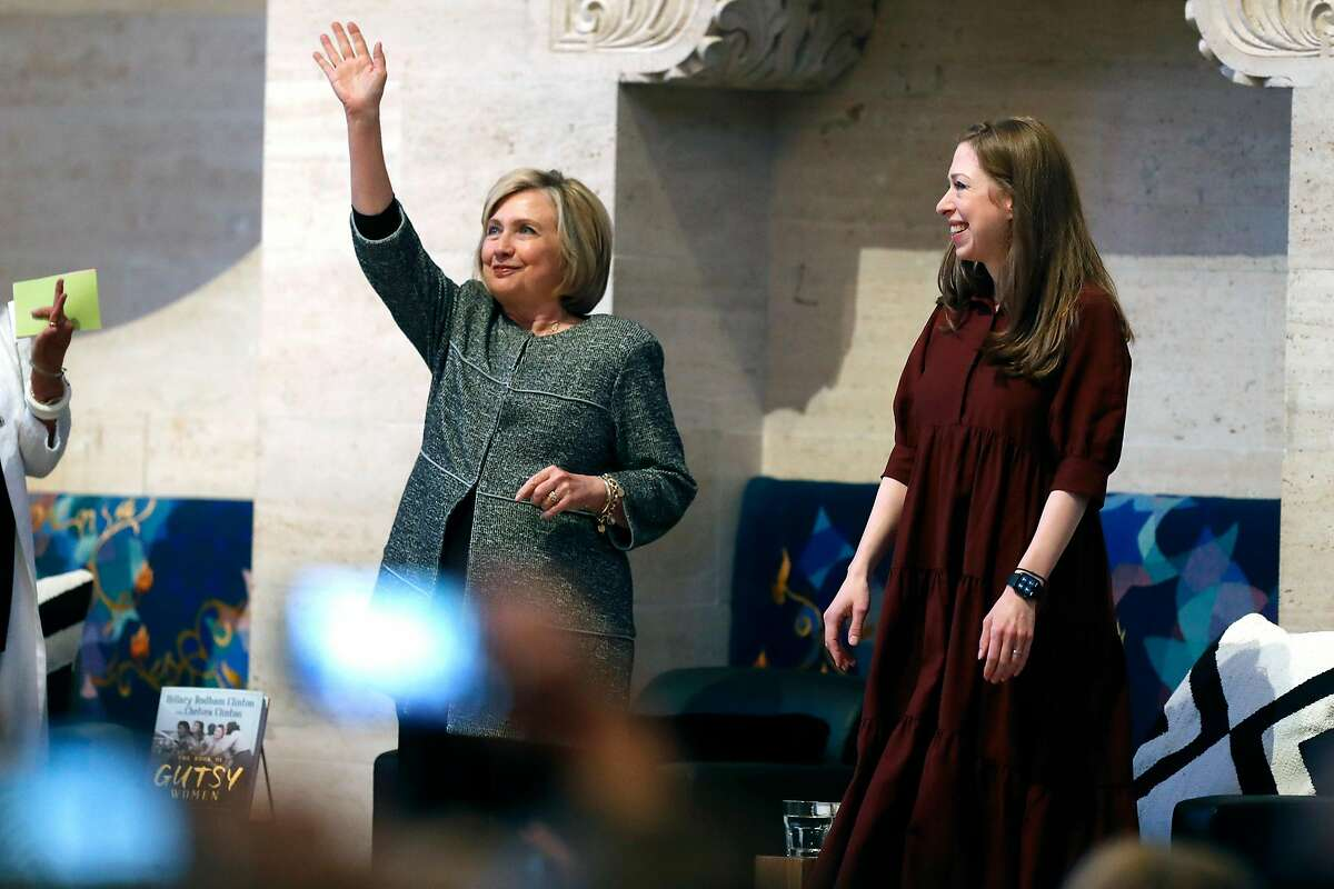 Hillary Clinton acknowledges an ovation by the audience as she is introduced while appearing with her daughter, Chelsea, during book tour stop at Temple Emanu-El in San Francisco, Calif., on Sunday, October 20, 2019.