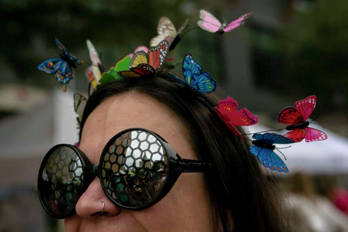 Chrissy Hejny of Austin poses wearing butterfly themed accessories during 4th annual Monarch Butterfly and Pollinator Festival at the Pearl in San Antonio, Texas, Oct. 20, 2019.