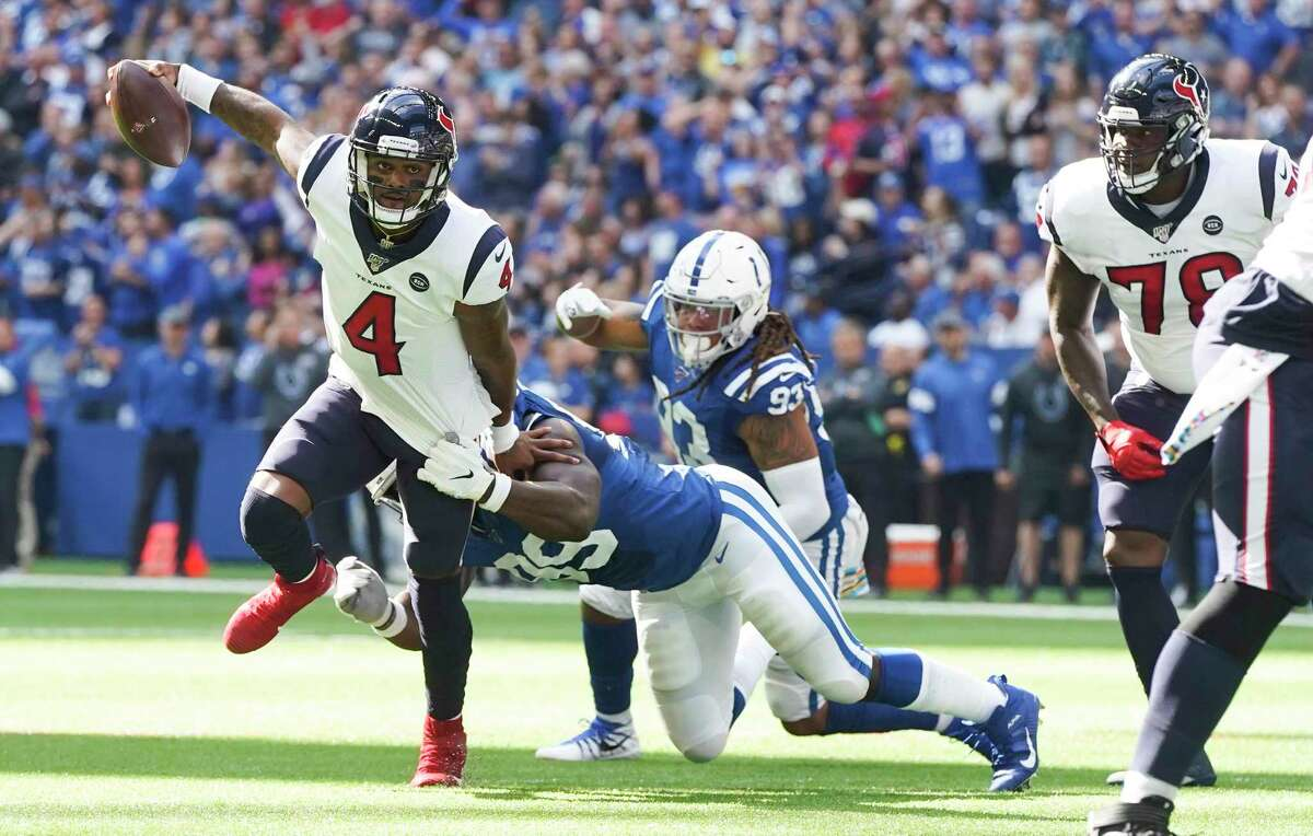 Houston Texans quarterback Deshaun Watson (4) avoids a sack by Indianapolis Colts defensive end Justin Houston (99) in the first half at Lucas Oil Stadium on Sunday, Oct. 20, 2019 in Houston.