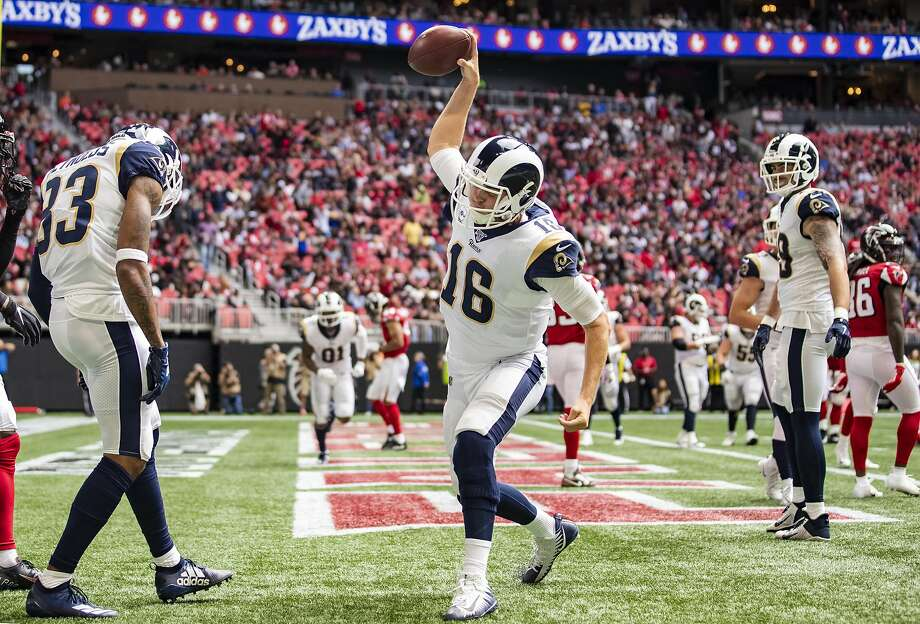 Rams QB Jared Goff spikes the football after scoring on a 1-yard run in the third quarter. In addition to his sixth career TD run, he passed for two touchdowns against the Falcons. Photo: Carmen Mandato / Getty Images