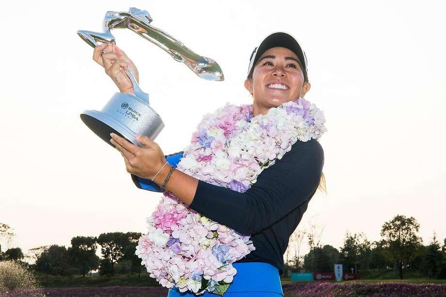 American Danielle Kang hoists the trophy after winning the Buick LPGA Shanghai at Shanghai Qizhong Garden Golf Club. Photo: Yifan Ding / Getty Images