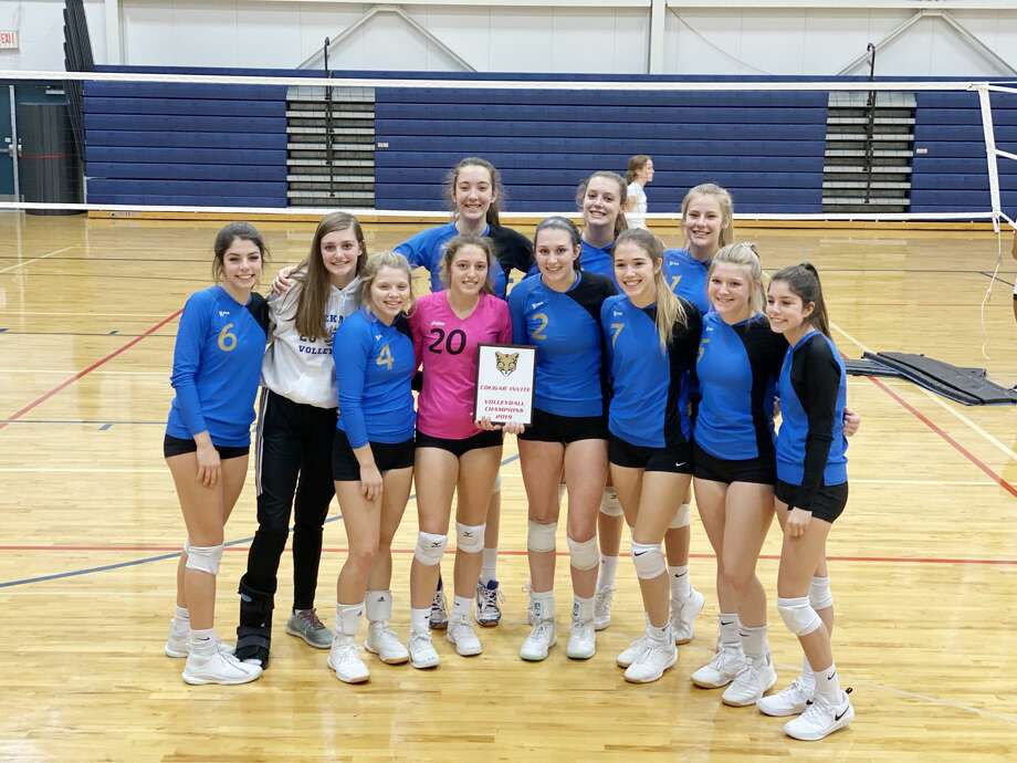 The Onekama volleyball team poses with their plaque after winning the Big Rapids Crossroads Invitational on Saturday. (Courtesy photo) Photo: Courtesy Photo