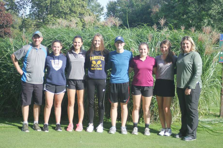 The Manistee girls golf team, pictured (from left to right): assistant coach Chad Murray, Amy Bagley, Marial Rahn, Ari Kamaloski, Trista Arnold, Lily Sandstedt, Sara Thompson and head coach Bridget Warnke. Photo: News Advocate File Photo