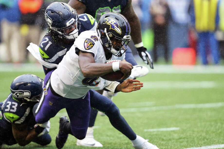 Baltimore Ravens quarterback Lamar Jackson (8) dives for an 8-yard touchdown in the third quarter of Seattle's game against Baltimore, Sunday, Oct. 20, 2019 at CenturyLink Field. Photo: Genna Martin, Seattlepi.com / GENNA MARTIN
