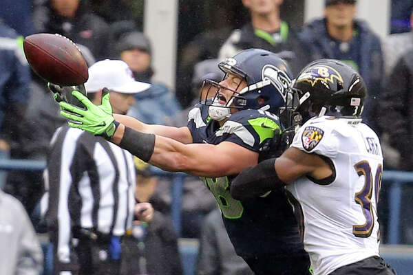 Seattle Seahawks tight end Jacob Hollister (48) is unable to make the catch as Ravens Brandon Carr (30) defends in the second quarter of Seattle's game against Baltimore, Sunday, Oct. 20, 2019 at CenturyLink Field.