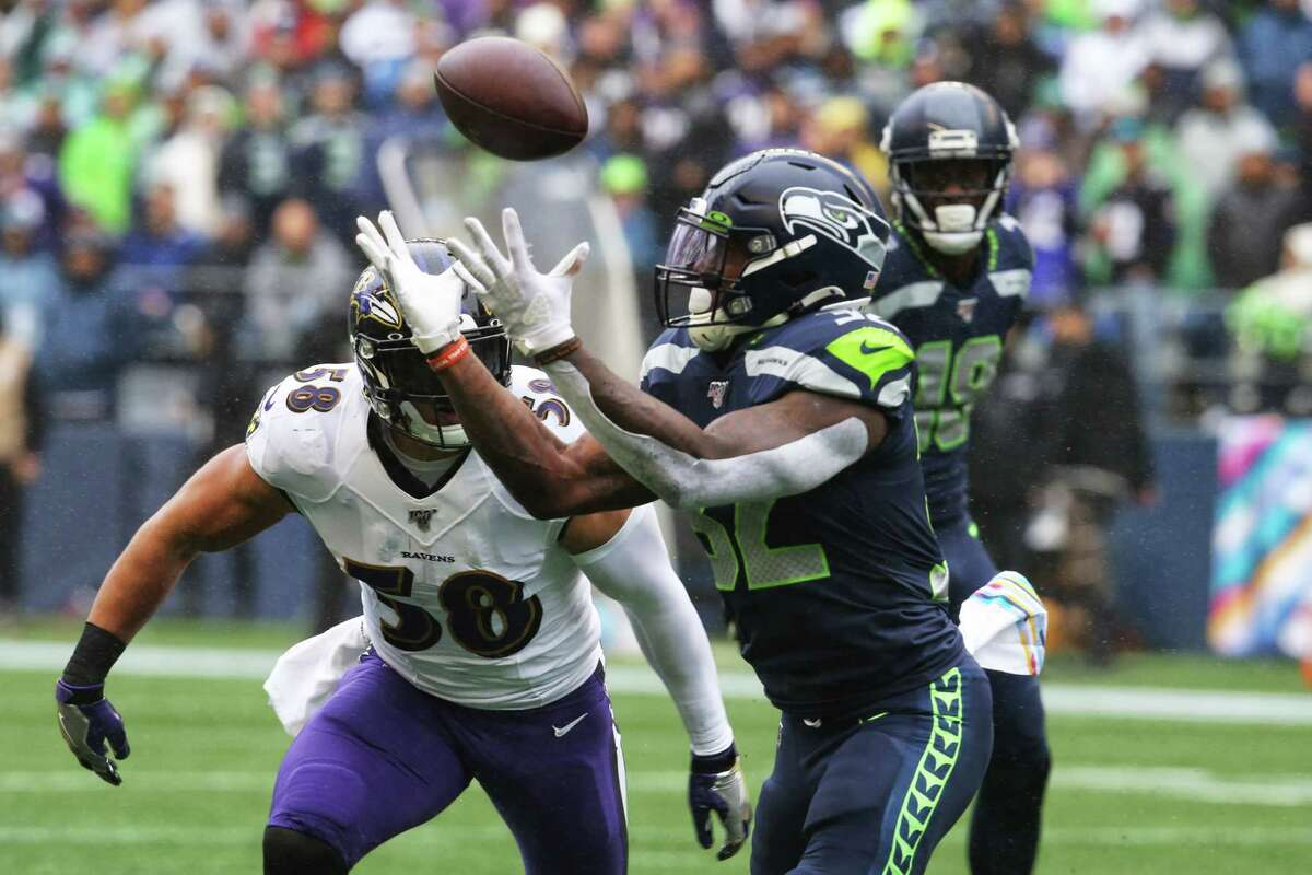 Seattle Seahawks running back Chris Carson (32) brings in a catch during the first half of Seattle's game against Baltimore, Sunday, Oct. 20, 2019 at CenturyLink Field.