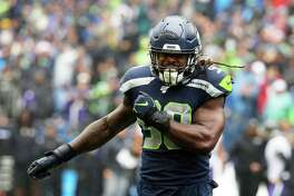 Seattle Seahawks outside linebacker Jadeveon Clowney (90) celebrates a tackle during the first half of Seattle's game against Baltimore, Sunday, Oct. 20, 2019 at CenturyLink Field.