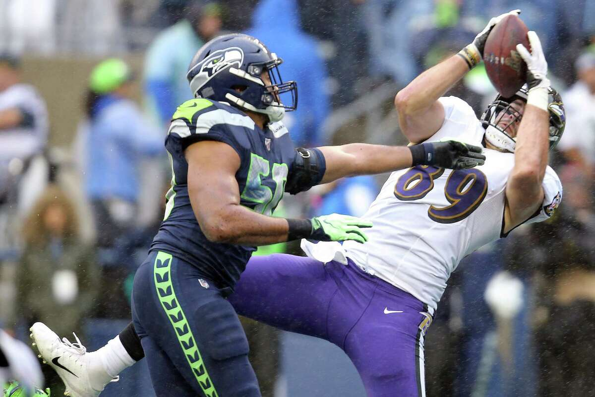 Baltimore Ravens tight end Mark Andrews (89) attempts to bring in what was an imcomplete pass ahead of Seattle Seahawks outside linebacker K.J. Wright (50) in the second quarter of Seattle's game against Baltimore, Sunday, Oct. 20, 2019 at CenturyLink Field.\