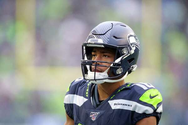 Seattle Seahawks wide receiver Tyler Lockett (16) prepares for a punt return in the third quarter of Seattle's game against Baltimore, Sunday, Oct. 20, 2019 at CenturyLink Field.