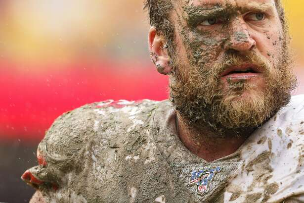 LANDOVER, MARYLAND - OCTOBER 20: Covered in mud, offensive guard Mike Person #68 of the San Francisco 49ers looks on after making a tackle on defensive back Troy Apke #30 of the Washington Redskins (not pictured) during the third quarter at FedExField on
