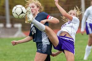 Voorheesville midfielder Lily Farrell gets a foot on the ball in front of Cohoes midfielder Shannon Cepiel during a Colonial Council matchup at Cohoes High School on Sunday, Oct. 21, 2019 (Jim Franco/Special to the Times Union.)