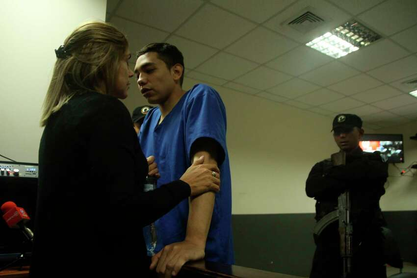 FILE - In this Oct. 11, 2019 file photo, Orlando Tercero visits with his mother Martha Moreno, during a court recess, in Managua, Nicaragua. Moreno is accused of killing 22-year-old U.S. nursing student Haley Anderson in 2018. The court proceeding is taking place in Managua, Nicaragua, with a Nicaraguan prosecutor and a Nicaraguan judge applying that countrya€™s law. Witnesses have been testifying from Binghamton via streaming video. (AP Photo/Oscar Duarte, File)