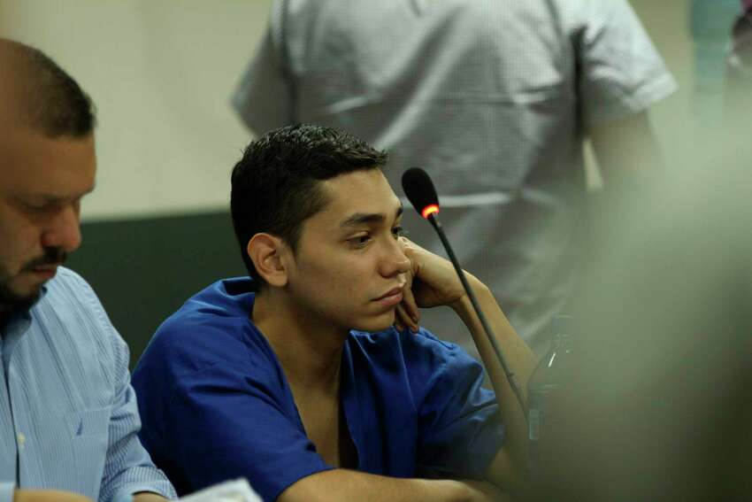 FILE - In this Oct. 11, 2019 file photo, lawyer Eduardo Rubi, left, appears in court with his client Nicaraguan Orlando Tercero in Managua, Nicaragua. Moreno is accused of killing 22-year-old U.S. nursing student Haley Anderson in 2018. The court proceeding is taking place in Managua, Nicaragua, with a Nicaraguan prosecutor and a Nicaraguan judge applying that countrya€™s law. Witnesses have been testifying from Binghamton via streaming video. (AP Photo/Oscar Duarte, File)